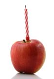 Happy Healthy Birthday!. Birthday humor: apple with a birthday candle instead of a cake. Associates with diet and healthy food Royalty Free Stock Photos