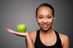 Happy healthy black asian woman with apple Stock Images