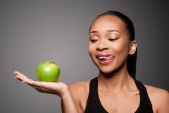 Happy healthy black asian woman with delicious apple Royalty Free Stock Images