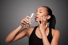 Happy healthy black asian woman enjoying water Stock Photos