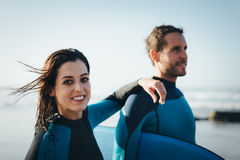 Happy healthy bodyboard couple Stock Photography
