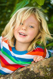 Happy, healthy child climbing tree at the beach Royalty Free Stock Photography