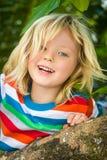 Happy, healthy child climbing tree at the beach Royalty Free Stock Photography
