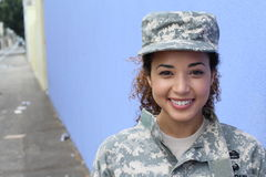 Happy healthy ethnic army female soldier.  stock photo