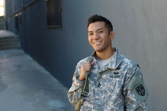 Happy healthy ethnic army soldier with copy space on the left stock photos