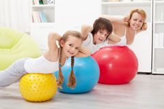 Happy healthy family exercising Royalty Free Stock Photo