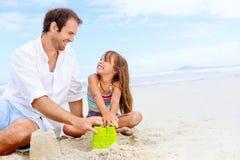 Happy sand castle child Stock Images