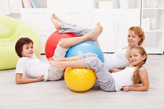 Happy healthy family with large gymnastic balls Stock Photo