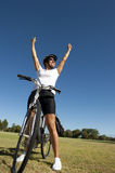 Happy healthy female cyclist Royalty Free Stock Photography