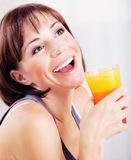 Happy healthy female drinking juice Royalty Free Stock Photo