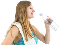 Happy healthy fitness woman drinking water. Young and attractive fitness woman drinking water during sports. Isolated on white background Stock Photos