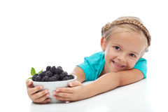 Happy healthy girl with a bowl of blackberries Royalty Free Stock Photography