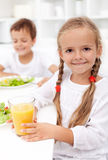 Happy healthy kids eating. Fresh food - closeup Stock Photos