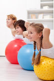 Happy healthy kids exercising Stock Images