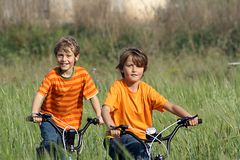 happy healthy kids riding bikes Stock Images
