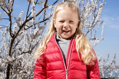 Happy healthy little girl enjoying springtime outdoors. royalty free stock photo