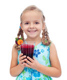 Happy healthy little girl with fresh juice Royalty Free Stock Image