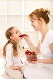 Happy healthy people eating fresh strawberries Stock Photo
