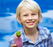 Happy, healthy school child with fresh fruit smoothie. By pool royalty free stock photo