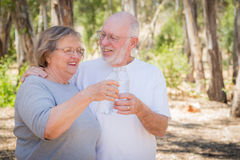 Happy Healthy Senior Couple with Water Bottles Royalty Free Stock Photography