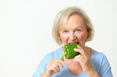 Happy healthy senior lady with a green pepper Royalty Free Stock Photography
