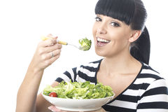 Happy Healthy Smiling Woman Eating a Green Healthy Large Salad Stock Photography