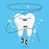 Happy healthy tooth with flossing Royalty Free Stock Photo