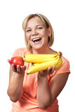 Happy and healthy woman with banana and apple Stock Photos
