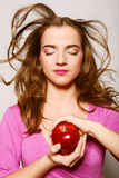 Happy healthy woman holding apple Royalty Free Stock Image