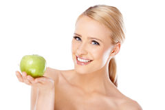 Happy and healthy woman holding apple Royalty Free Stock Photography