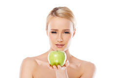 Happy and healthy woman holding apple Stock Photography