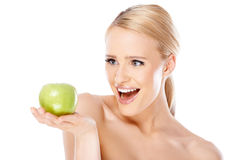 Happy and healthy woman holding apple Royalty Free Stock Photos