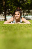 Happy healthy woman lying on grass Stock Photos