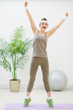 Happy healthy woman making gymnastics Stock Image