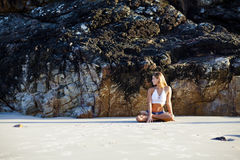 Happy and healthy woman meditating on beach Royalty Free Stock Image