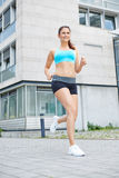 Happy healthy woman running in city Royalty Free Stock Photo