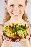 Happy healthy woman with salad Royalty Free Stock Image