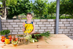 Happy healthy young girl preserving veggies Royalty Free Stock Images
