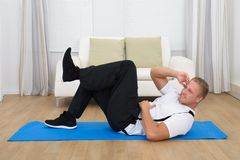 Happy healthy young man exercising Stock Photo