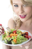 Happy Healthy Young Woman Eating Colourful Salad Royalty Free Stock Image