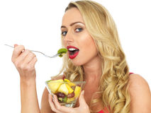 Happy Healthy Young Woman Eating Fresh Fruit Salad Royalty Free Stock Photography