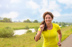 Happy healthy young woman out jogging Royalty Free Stock Photos