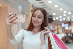 Beautiful young woman shopping at the local mall stock photo