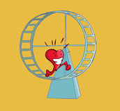 Happy heart running on a hamster wheel. Royalty Free Stock Photo