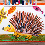 Happy hedgehog and autumn leaves stock photo