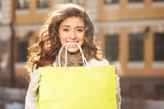 Happy with her retail session. Beautiful young women holding the Royalty Free Stock Image