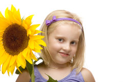 Happy hhild holding sunflower in hands Stock Images