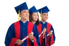 Happy high school graduates Stock Photos