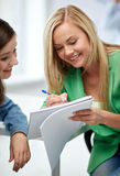 Happy high school student girls with note book Stock Image
