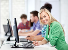 Happy high school students in computer class Stock Photos